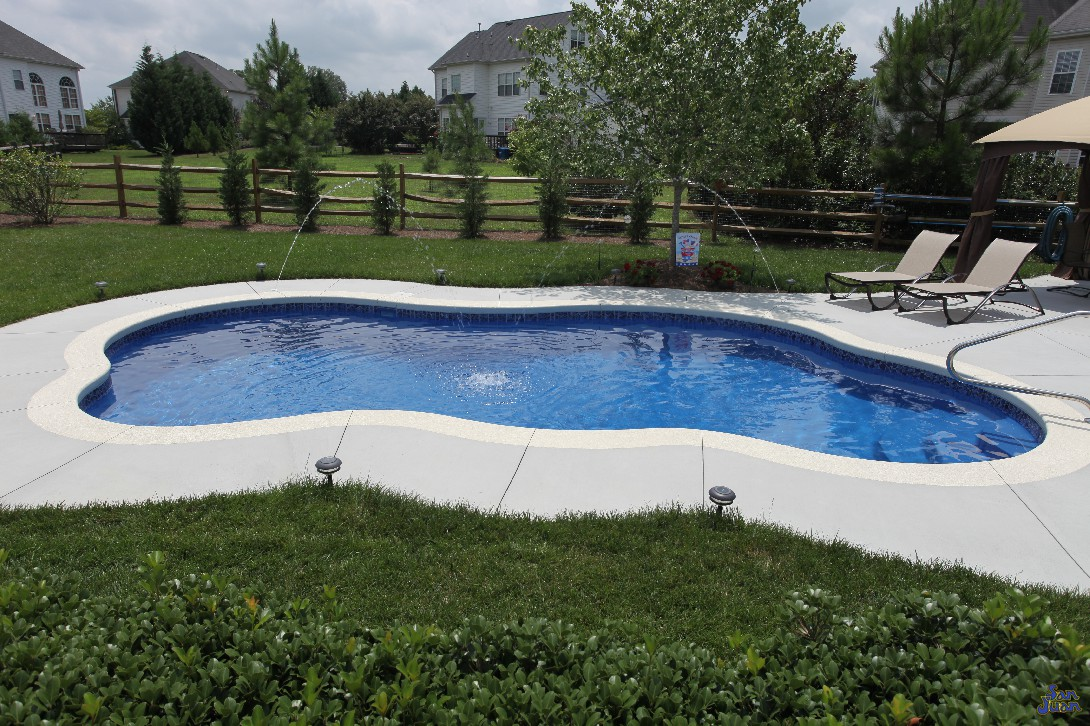 Inground pools to fit every backyard space and budget for Fiberglass pool installation